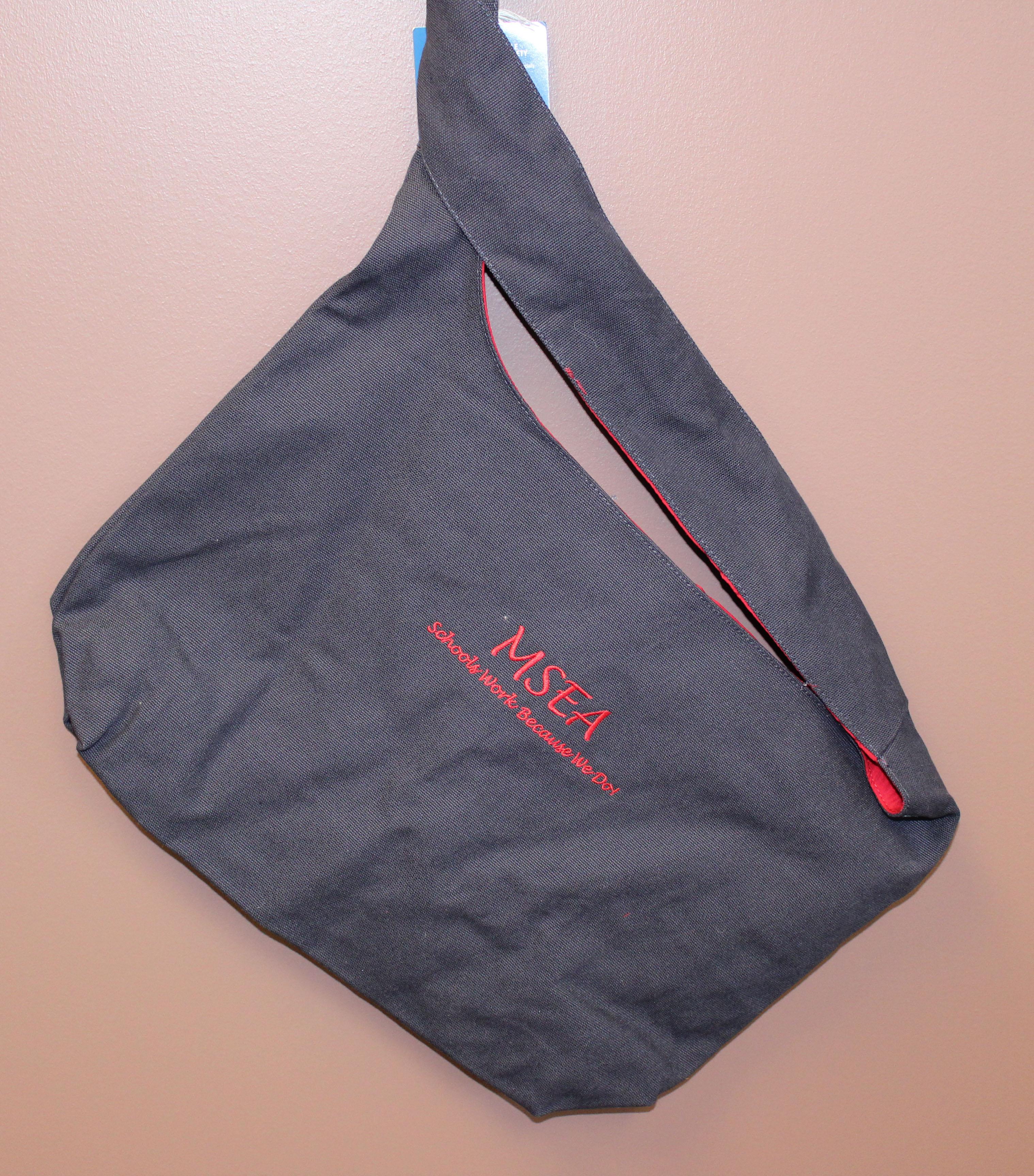black MSEA messenger bag